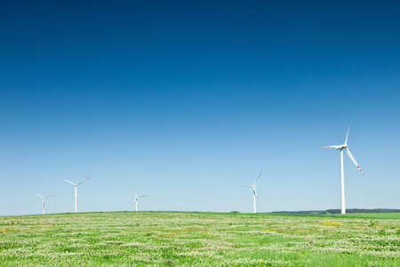 group of wind turbines on green field photo