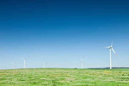 group of wind turbines on green field photo