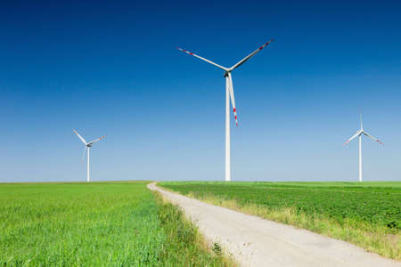 wind turbines and empty country road photo