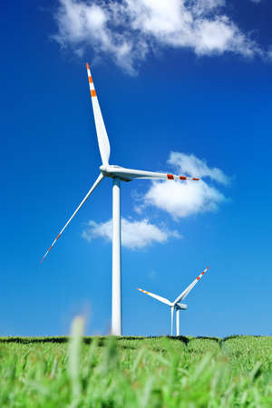 summer view of two wind turbines from grass leve photo