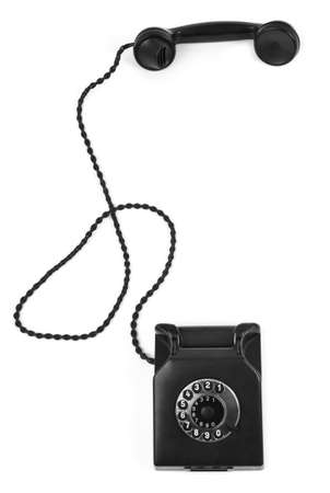 old bakelite telephone on white background, gentle natural shadow in front photo
