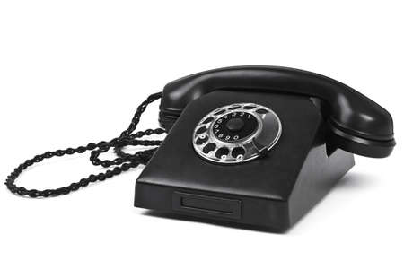 old bakelite telephone on white, natural shadow in front photo