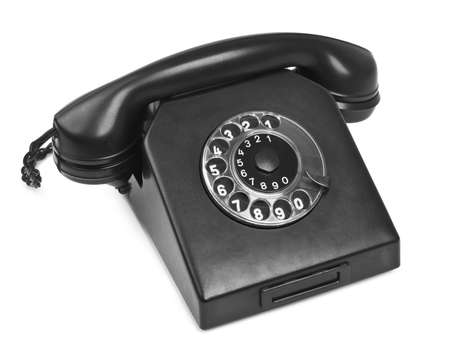 bakelite: old bakelite telephone on white, natural shadow in front