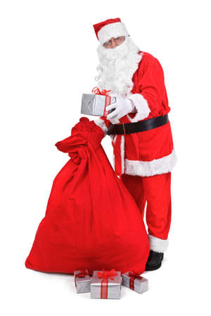 Santa claus gives a present on white background photo