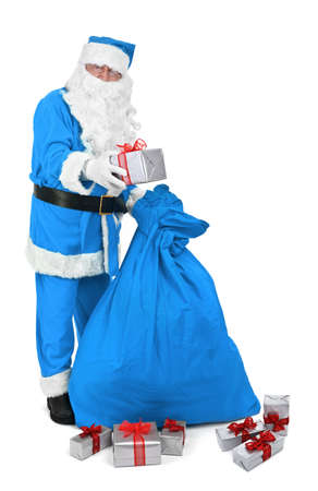 sackful: Santa claus in blue costume gives a present on white background