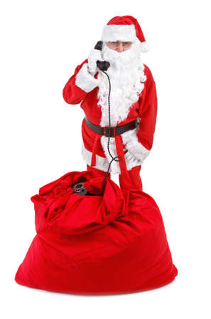 Santa claus receives a phone call on white background photo
