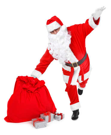 funny pose of santa claus on white background photo