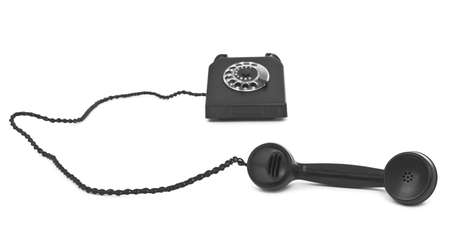 bakelite: old bakelite telephone on white, natural shadow in front, shallow DOF,  focus set on handset
