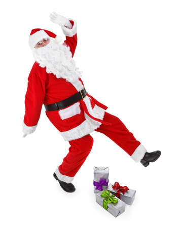 funny pose of santa claus on white background photo