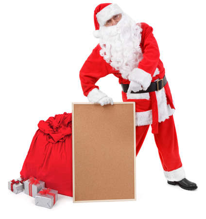 Santa claus shows empty bulletin board on white, minimal natural shadow in front photo
