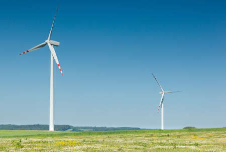 two wind turbines and blue sky  photo