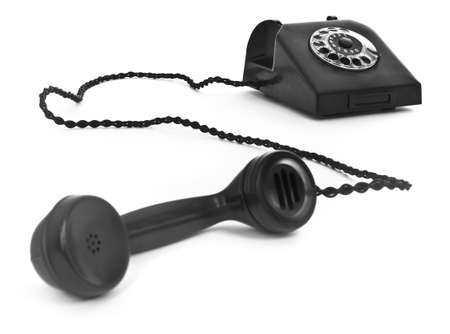rotary phone: old bakelite telephone on white background, focus set in background