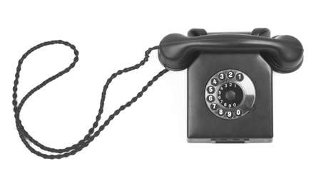bakelite: old bakelite telephone on white background, minimal natural shadow in front Stock Photo