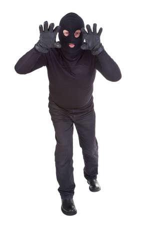 Burglar attack against white background photo