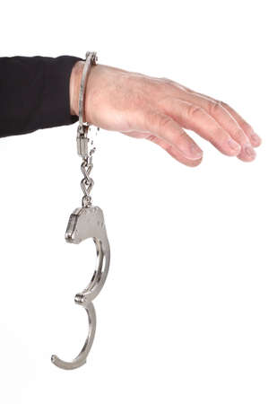 object oppression: thiefs hand in handcuffs isolated on white background
