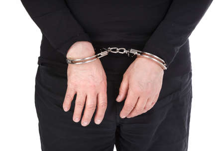 object oppression: thiefs hands in handcuffs isolated on white background