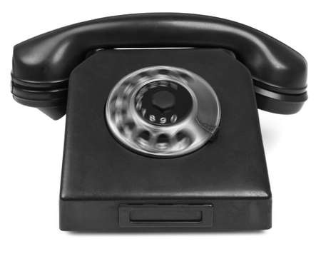 old bakelite telephone with spining dial on white background photo