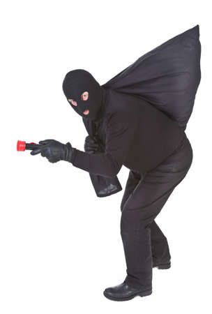 kidnapper: robber with flashlight and sack isolated on white