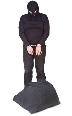 object oppression: thief with sack handcuffed and isolated on white background Stock Photo