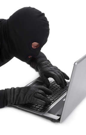 horrifying: concept of data thief with laptop isolated on white background Stock Photo