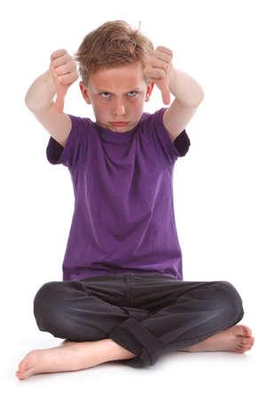태도: kid showing thum down, against white background