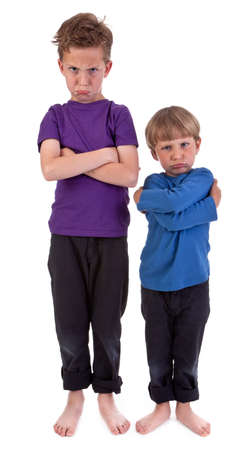 Two angry boys against white background