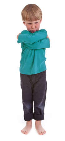 small angry boy against white background