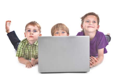 studio shot of three kids with laptop  photo