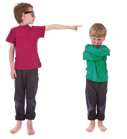 accusing: boy showing who is guilty on white background Stock Photo