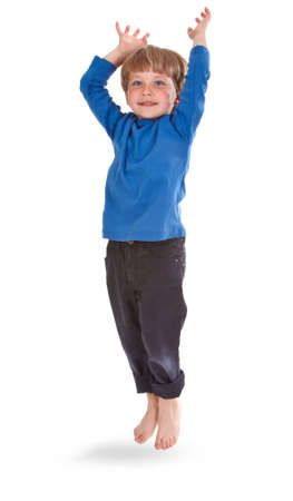 Happy boy jumping over white background, small shadow under him photo
