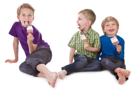 messily: three funny kids eating ice lolly on white background messily