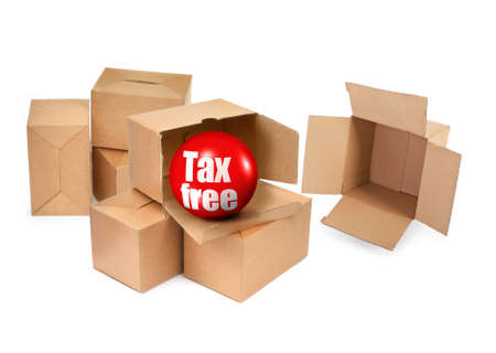 tax free concept - cardboard boxes and 3D sale ball