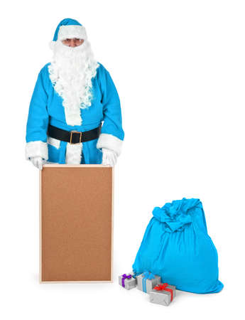 sackful: Blue santa claus shows empty bulletin board on white, minimal natural shadow in front Stock Photo