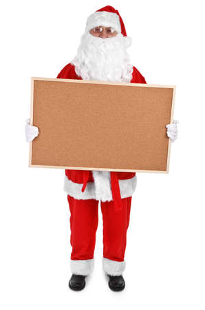 Santa claus and empty bulletin board on white background photo