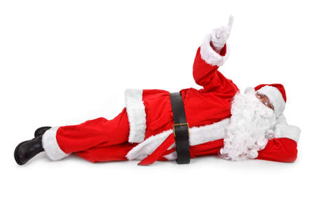 Santa is pointing his finger at an object above him Stock Photo - 10890401
