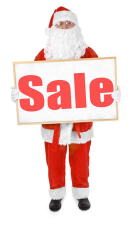Santa claus showing bulletin board with Sale inscription photo