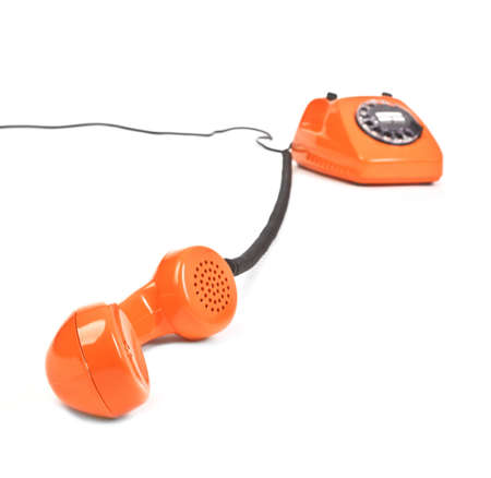 classic dial phone on white background, focus set in foreground Stockfoto