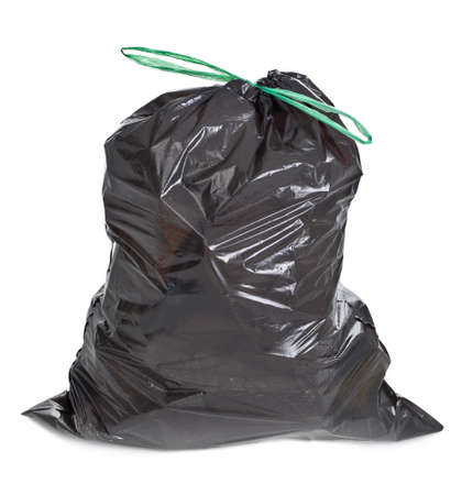 tied garbage bag on white background photo
