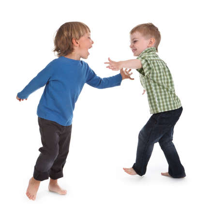 two boys having fun on white background