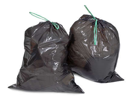 two tied garbage bags on white background
