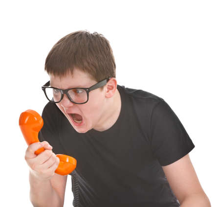 angry kid screams into the telephone receiver on white background photo