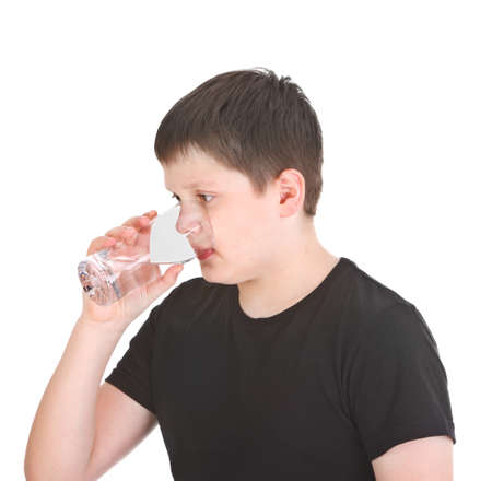 boy drinking water on white background photo