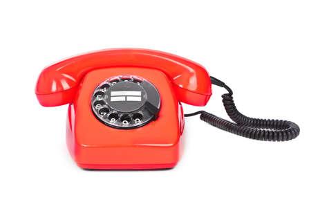 bakelite: red bakelite phone on white background