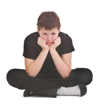 sad boy over white background Stock Photo - 12226015
