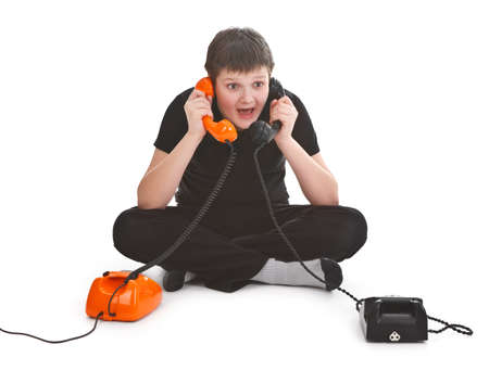 boy having two phone calls at the same time photo