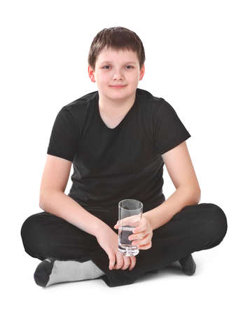 boy holding glass of water over white background Stock Photo - 12226136