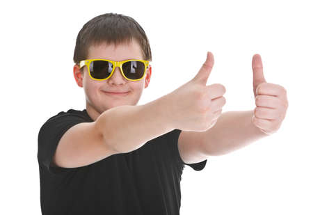 boy with sunglasses showing thumb up sign over white background Stock Photo - 12226134