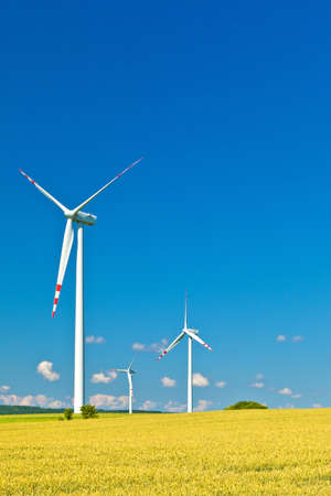 three wind turbines and blue sky Stock Photo - 12226057