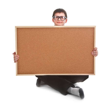 young boy and empty bulletin board on white background photo