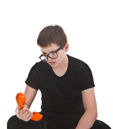 Portrait of a young boy getting bored during phone call photo